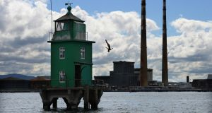 Cliff Diver, Anna Bader, diving from North Bank Lighthouse, Dublin Bay in May to celebrate the return of the Red Bull Cliff Diving World Series to Ireland. Photograph: Dara Mac Donaill / The Irish Times