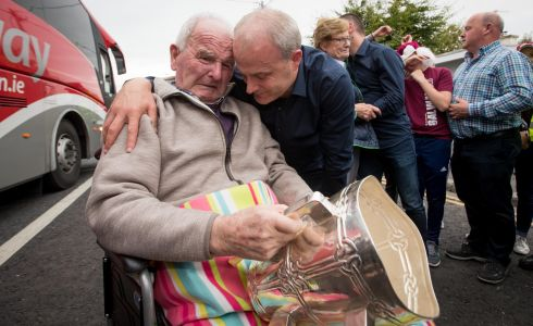 Galway manager Micheal Donoghue shows the Liam McCarthy to his father Miko Donoghue for the first time in Ballinasloe, GAA All-Ireland Hurling Champions Galway Homecoming, Ballinasloe, Galway in September.  Photograph: Morgan Treacy / INPHO