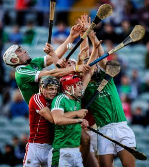 Limerick and cork players compete for the ball, Bord Gais Energy GAA Hurling U21 Munster Final, Gaelic Grounds, Limerick in July.  Photograph: Tommy Dickson  / INPHO
