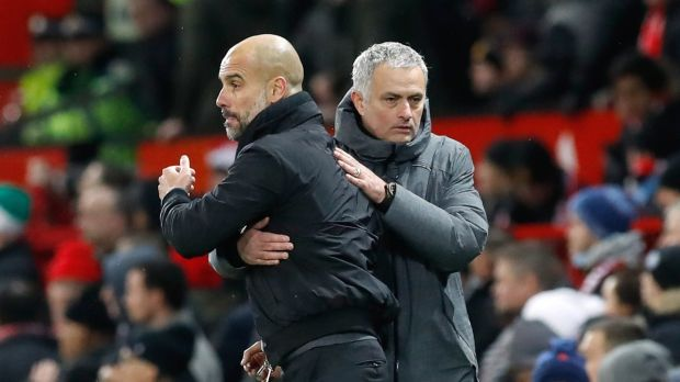 Mourinho and Guardiola shake hands after the game. Photo: Martin Rickett/PA Wire