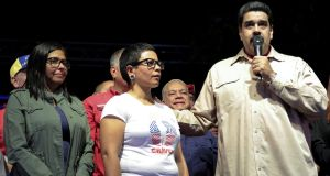 Venezuela's president Nicolas Maduro stands next to the newly-elected mayor of Libertador district,  Erika Farias (centre) and the president of Venezuela's National Constituent Assembly, Delcy Rodriguez (left), in Caracas on Sunday. Photograph: Miraflores Palace  via Reuters