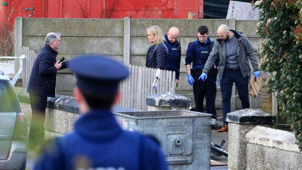 Gardaí at the scene of a shooting in Parlickstown Gardens in west Dublin this afternoon. Photograph: Collins
