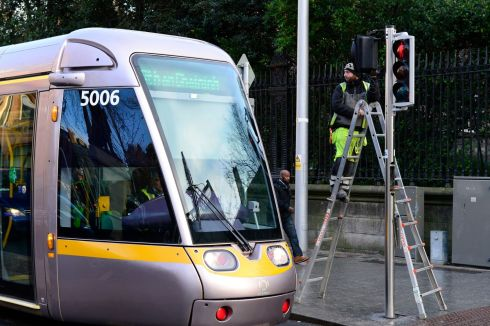 FALSE START: Adjusting the lights on College Street for the Luas on to College Green. A traffic signalling failure in Dublin caused traffic chaos across the city on Monday morning, the first weekday of the new Luas Cross City service. Photograph: Cyril Byrne/The Irish Times
