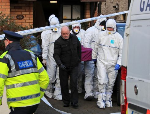 SUSPICIOUS DEATH: Gardaí remove the remains from the scene in Woodville Avenue, Lucan, where the body of a man in his 20s was discovered. Photograph: Colin Keegan, Collins Dublin