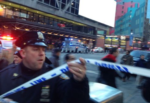 TERROR THREAT: Police respond to a report of an explosion near Times Square on Monday, in New York. Four people suffered minor injuries after a 'terror attempt' on the subway system. Photograph: Charles Zoeller/AP