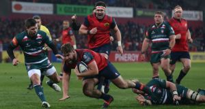 Munster's Rhys Marshall scores a try against Leicester last Saturday. Munster know well a wounded Tiger can be a dangerous animal. Photograph: Niall Carson/PA Wire.