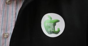 'Athenry for Apple' badge on supporter outside the Four Courts. Photograph: Collins Courts