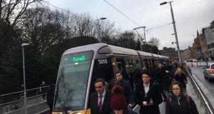 Commuters exit the Luas at Stephen's Green on Tuesday. Source: Jack Power