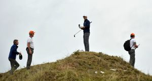 Jordan Spieth plots his course after landing in the rough off the 13th tee during the final round of the British Open at Royal Birkdale. Photograph: Hannah McKay/Reuters
