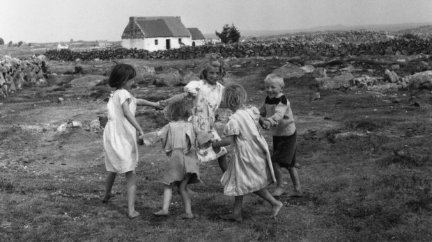 Irish children play a game in Co Galway in 1957. Photograph: Haywood Magee/Picture Post/Getty Images