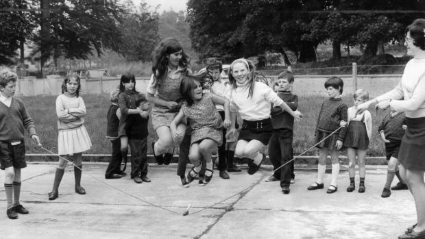 Young girls jump over a skipping rope in the playground of Donard National School, Co Wicklow, in October 1971. Photograph: Mirrorpix via Getty Images