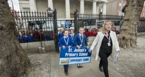 Louise Tobin, principal of St Joseph's primary school, leads children from five schools in Tipperary town who gathered at the Department of Education earlier this year to protest at their 'exclusion' from the Deis scheme for disadvantaged schools. Photograph: Brenda Fitzsimons
