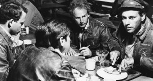 Alan Arkin (right) as Captain John Yossarian and Art Garfunkel (centre) as Captain Nately in the film version of JosephHeller's Catch-22 (1970). Photograph: John Springer Collection/ Corbis via Getty Images