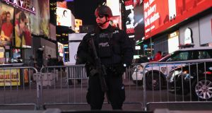 A New York policeman stands guard in Times Square not far from the site of a pipe bomb explosion on December 11th. Photograph: John Moore/Getty Images