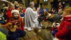 THERAPY DOGS: The Rev Dermot Dunne, Dean of Christ Church Cathedral, gives a blessing during a Christmas carol service with Peata Therapy  Dogs. Photograph: Cyril Byrne/The Irish Times