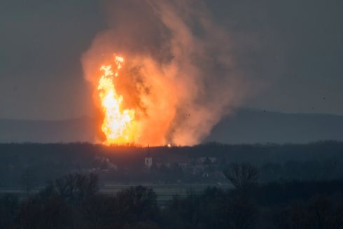 GAS BLAST: A column of fire is seen after an explosion ripped through Austria's main gas pipeline hub in Baumgarten, Austria. Photograph: Tomas Hulik/Reuters