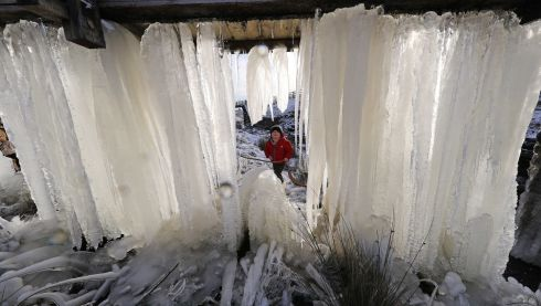 COLD OUT THERE: Three-year-old Reuben looks at a wall of icicles at Killhope mine in County Durham, as Britain had its coldest night of the year with vast swathes of the country falling below freezing. Photograph: Owen Humphreys/PA Wire