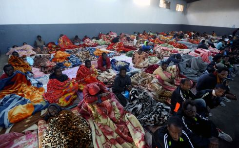 DETENTION CENTRE: African migrants sit in a shelter at the Tariq Al-Matar migrant detention centre on the outskirts of the Libyan capital, Tripoli. Photograph: Mahmud Turkia/AFP/Getty Images