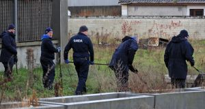 Gardaí  continue their investigations at the scene of Monday's triple shooting in Parlickstown Gardens. Photograph: Colin Keegan/Collins