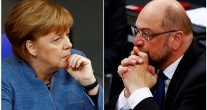 German chancellor Angela Merkel and SPD leader Martin Schulz:  The centre-left SPD wants greater social and infrastructure spending and reform of the two-tier health system. Photograph: Fabrizio Bensch/Reuters