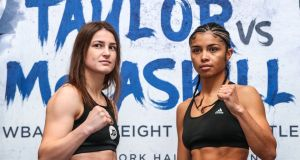 Katie Taylor and Jessica McCaskill during the weigh-in at the Courthouse Hotel, Shoreditch. Photo: James Crombie/Inpho