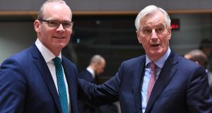 "Tánaiste and Minister for Foreign Affairs Simon Coveney and EU chief negotiator Michel Barnier:  ""There's a determination that what has been agreed in phase one would be properly protected and seen through,"" said Mr Coveney. Photograph: Emmanuel Dunand/AFP/Getty Images"