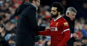 Liverpool manager Jürgen Klopp greets Mohamed Salah as he is substituted, with Everton manager Sam Allardyce standing nearby.  Photograph: Phil Noble/Reuters