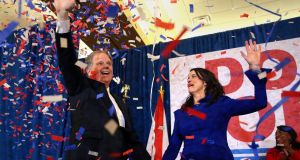 Democratic candidate  Doug Jones and his wife Louise wave to supporters in Birmingham, Alabama, on Tuesday night. Mr Jones is the first Democrat to win a Senate seat in Alabama for 25 years. Photograph:  John Bazemore/AP