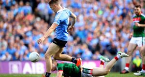 Con O'Callaghan scores an early goal for Dublin in the All-Ireland final victory over Mayo at Croke Park.  Photograph: Ryan Byrne/Inpho
