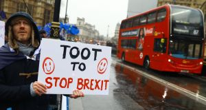 An anti-Brexit protester stands outside the Houses of Parliament in London. Photograph: Neil Hall/EPA