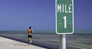 The  mile is an achievable distance for a beginner too. Photograph: Getty Images