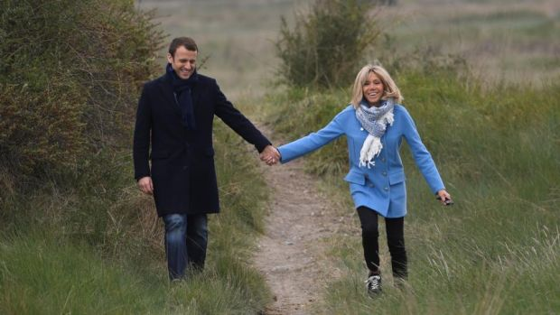 """A mixture of Gallic logic and alpha-male charm"": Emmanuel Macron with his wife, Brigitte Trogneux. Photograph: Eric Feferberg/AFP/Getty"