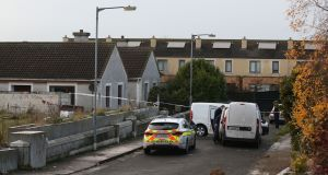 Gardaí  at Parslickstown Gardens in Blanchardstown where  an infant, a teenager and a woman were injured in a shooting on Monday. Photograph: Niall Carson/PA Wire.