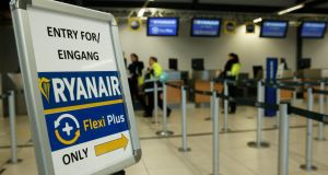 Ryanair  check-in counter at Berlin Schoenefeld. Photograph: Epa/Hayoung Jeon
