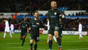 Manchester City's David Silva celebrates after scoring their third goal during the Premier League win over Swansea. Photo: Geoff Caddick/Getty Images