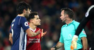 Philippe Coutinho of Liverpool argues with referee Paul Tierney during their Premier League clash against West Brom. Photo: Clive Brunskill/Getty Images