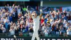 England's Dawid Malan celebrates his century during day one of the third Ashes Test in Perth. Photograph: Jason O'Brien/PA