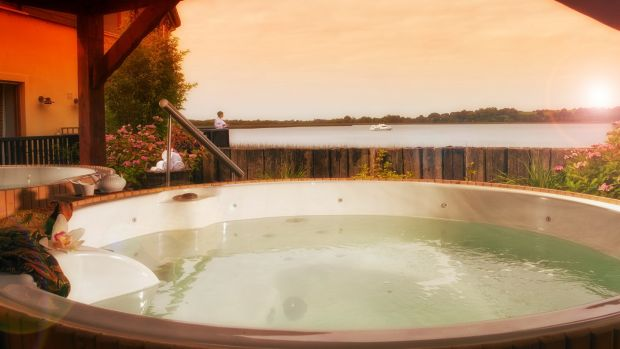 Ease away aches and pains in the hot tub overlooking the Shannon at the Wineport Lodge.