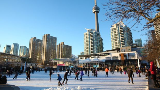 Toronto, Canada. Harbourfront with downtown Toronto buildings and CN Tower in the background. Winter leisure time in downtown Toronto. Visit a freind from €359 return for Christmas.