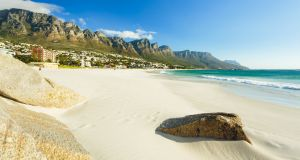 The 12 Apostles mountains framing the beach in Cape Town.
