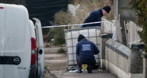 Gardaí at the scene of the shooting in  Parslickstown Gardens on Monday.  Photograph:  Niall Carson/PA