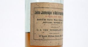 An archive of photographs of Co Leitrim by Leland Lewis Duncan fetched £9,375 (£8,000-£12,000) at Sotheby's, London An unopened 134-year-old bottle of 'John Jameson's Old Irish Whiskey', distilled in 1883, sold for €4,800 (€5,000-€7,000) at Whyte's Christmas sale