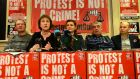 Vincent McGrath,   former MEP Patricia McKenna,  Annette Woolley,  Frank Donaghy and Solidarity TD Paul Murphy at a press conference ahead of the first trial of seven defendants   who were found not guilty    of the false imprisonment of former Labour leader Joan Burton  and her assistant. Photograph: Dara Mac Dónaill