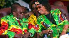 Zimbabwe's then president, Robert Mugabe, and his wife, Grace. Photograph: Tsvangirayi Mukwazhi/File/AP Photo