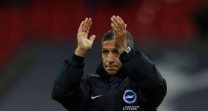 Brighton manager Chris Hughton applauds the fans after losing to Tottenham. Photograph: Dylan Martinez/Reuters