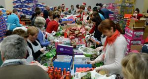 Food parcels being prepared after a Christmas Day dinner for people in need in the RDS. Photograph: Frank Miller