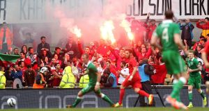 Turkish fans let off flares during the last friendly between the sides in 2014. Photograph: Ryan Byrne/Inpho