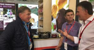 Shea O'Dwyer, right, founder of Coolmore Foods, speaking to delegates at a trade show