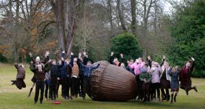 THE PEOPLE'S ACORN: Sixth class pupils from Gaelscoil Eoghain Uí Thuairisc, Carlow, with the sculpture after President Michael D Higgins and his wife Sabina unveiled 'Dearcán na nDaoine' - The People's Acorn on the grounds of Áras an Uachtaráin. Photograph: Nick Bradshaw