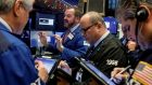 Traders working  the floor of the New York Stock Exchange on Thursday. Photograph: Reuters/Brendan McDermid